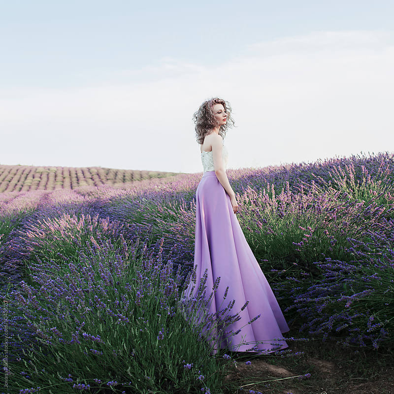 Artistic photo of a young woman in lavender by Jovana Rikalo for Stocksy United