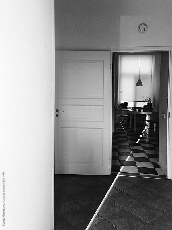 Room with ray of light by Lyuba Burakova for Stocksy United