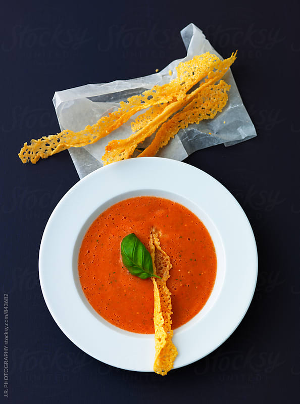 Cold tomato and pepper soup with cheese crisps by J.R. PHOTOGRAPHY for Stocksy United
