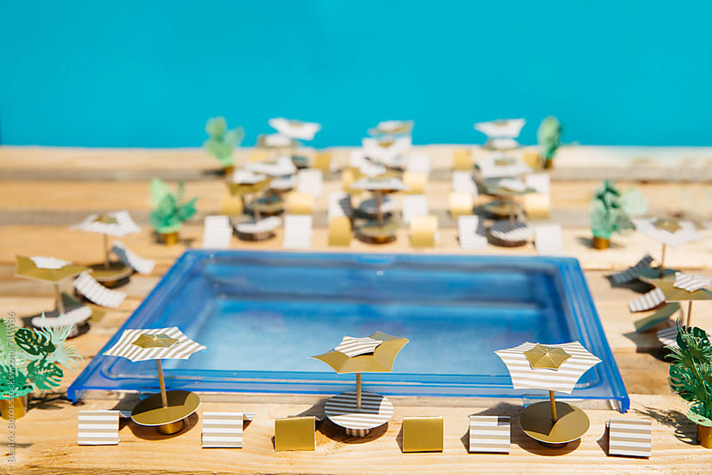 Pool area pf a luxury resort in Summer time made of paper craft by Beatrix Boros for Stocksy United