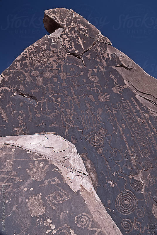 petroglyphs rock carvings on rock face in petrified forest national monument arizona by Ron Mellott for Stocksy United