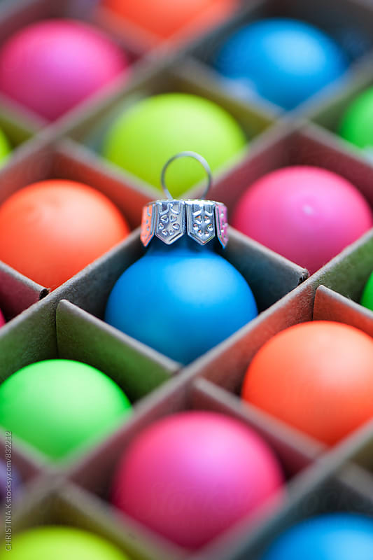Colourful baubles in a box by Christina Kilgour for Stocksy United