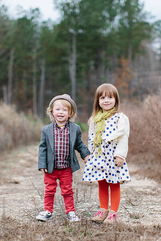 Stylish and cute young children holding hands by Jakob for Stocksy United