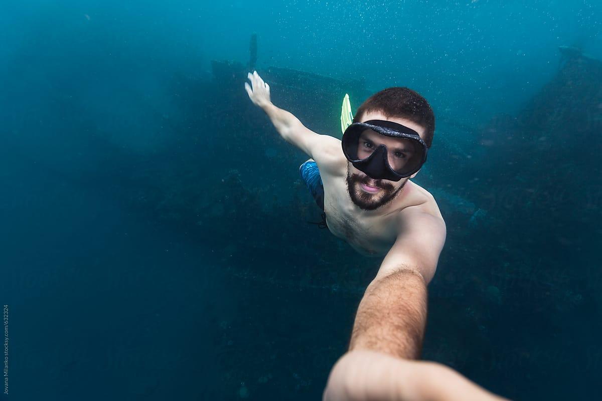 Man Taking Selfie Underwater Above A Shipwreck by Jovana Milanko - Underwater, Selfie