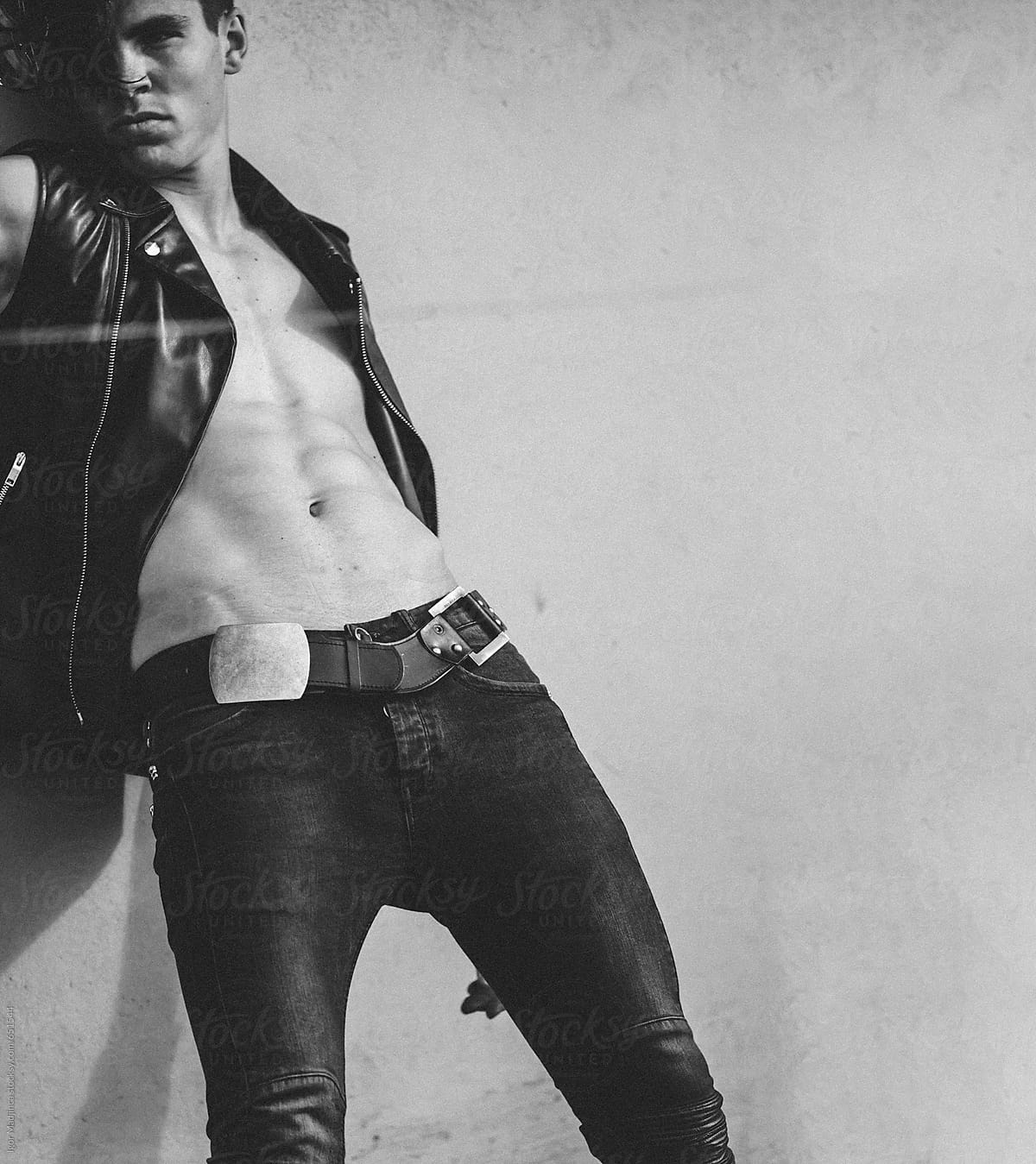 Black Fashion Models Poses: Pose,male Model Dressed In A Black Leather Vest Leaning