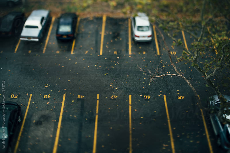 Cars parked in lot by Isaiah & Taylor Photography for Stocksy United