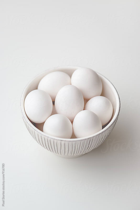 Bowl of white eggs by Pixel Stories for Stocksy United