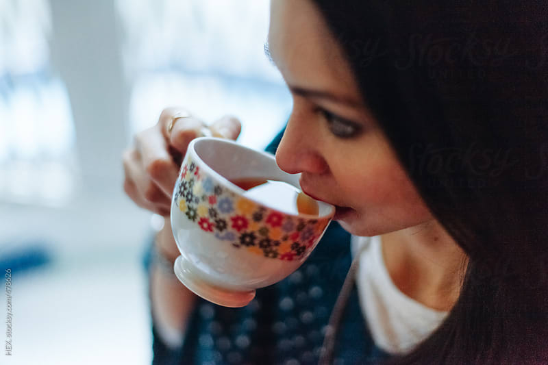 Beautiful Asiatic Woman Drinking a Cup of Tea  by HEX. for Stocksy United