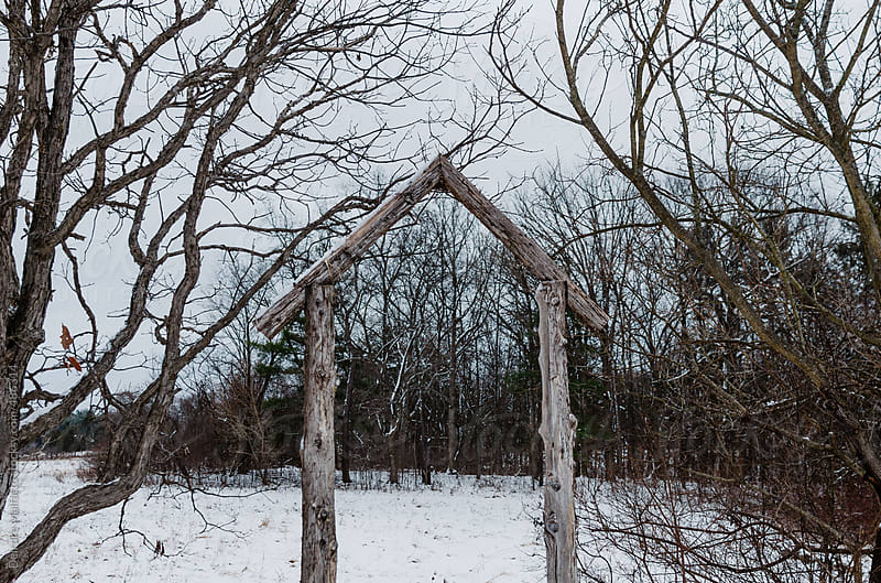 view of winter landscape through doorway by Deirdre Malfatto for Stocksy United
