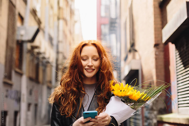 Young Woman Texting a message on the Mobile Phone by HEX . for Stocksy United
