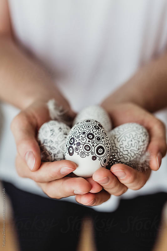Man holding Easter eggs by Tatjana Zlatkovic for Stocksy United