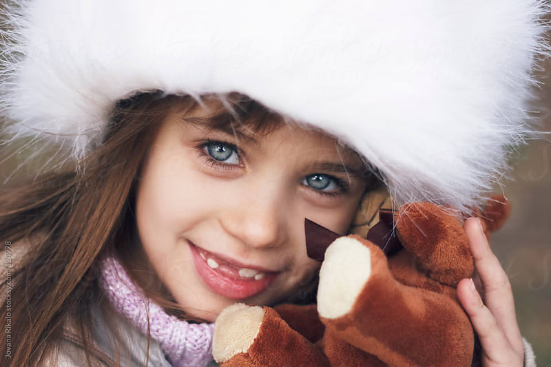 Little girl smiling with her teddy bear by Jovana Rikalo for Stocksy United