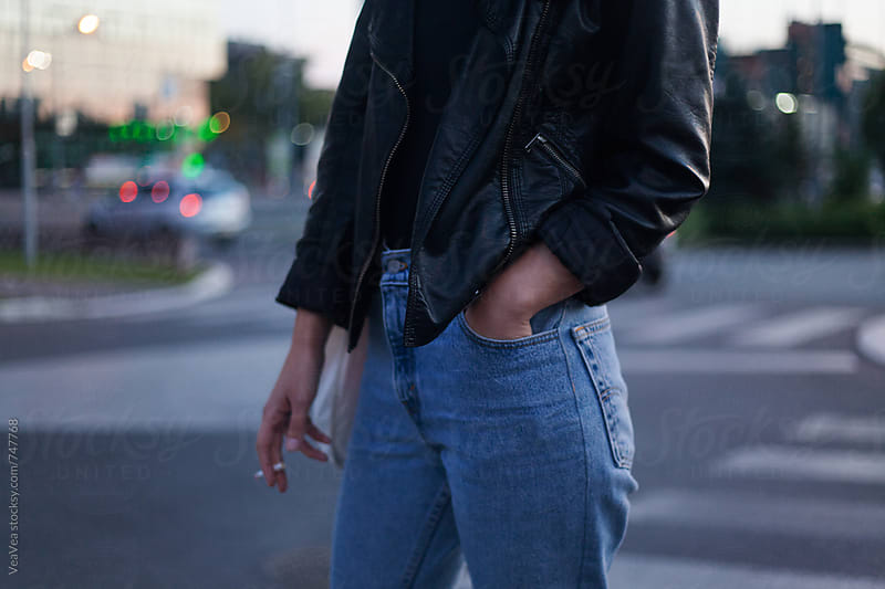 Stylish woman in the street during the sunset. Just body. by VeaVea for Stocksy United
