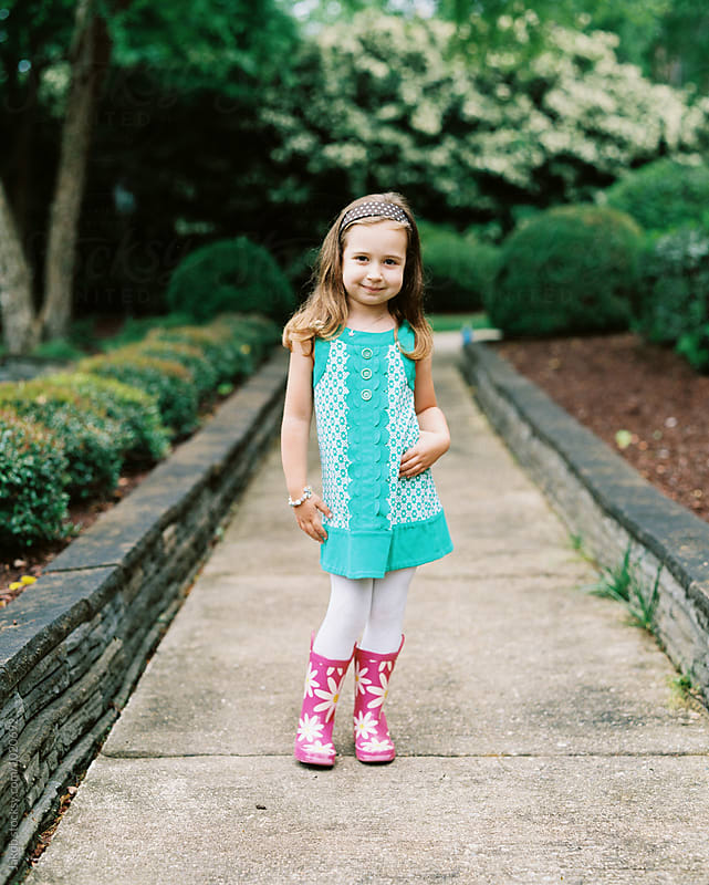 Cute young and fashionable girl standing on a sidewalk by Jakob for Stocksy United