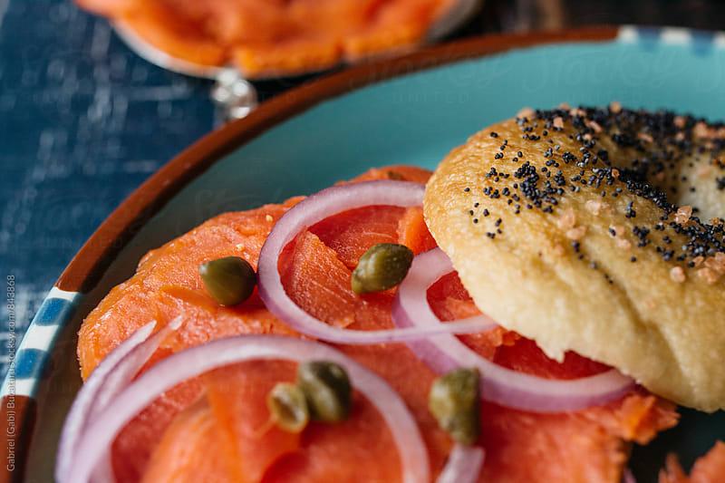 Smoked salmon on bagels by Gabriel (Gabi) Bucataru for Stocksy United