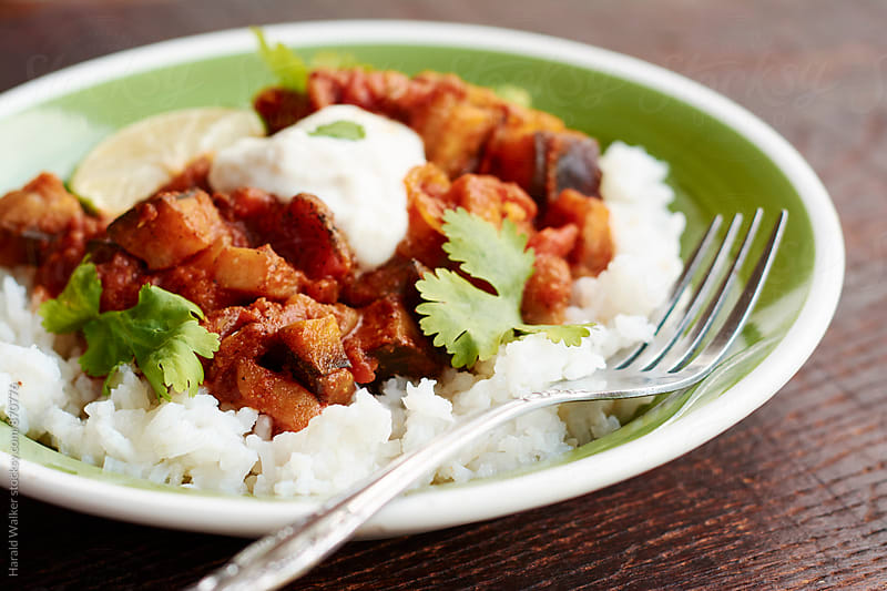 Tandoori Curried Eggplant and Tomatoes on Rice by Harald Walker for Stocksy United
