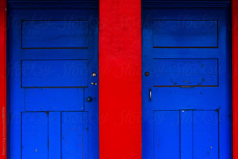 Two blue doors by Robert Lang for Stocksy United