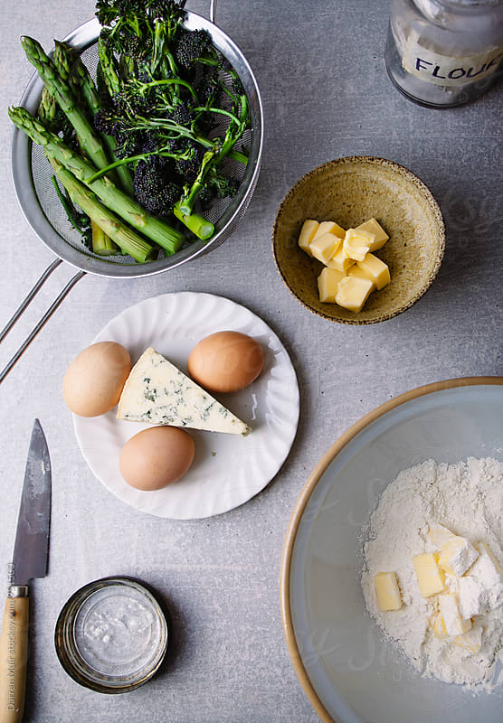 Ingredients to make a quiche on a concrete surface. by Darren Muir for Stocksy United