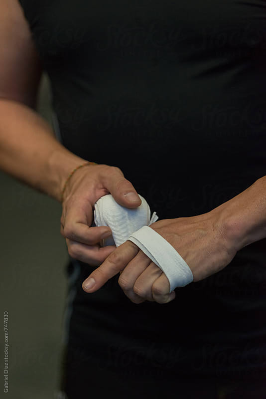 Taped hands in crossfit gym by Gabriel Diaz for Stocksy United