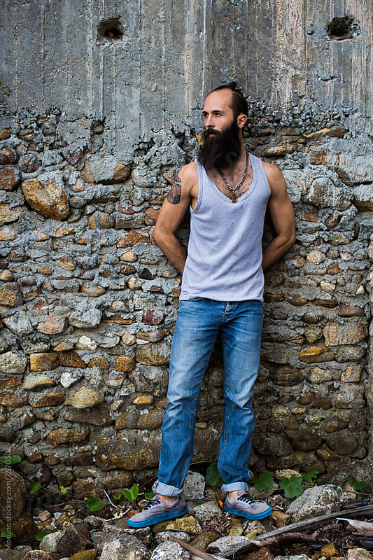 Man With Long Beard Standing Against the Wall by Mosuno for Stocksy United