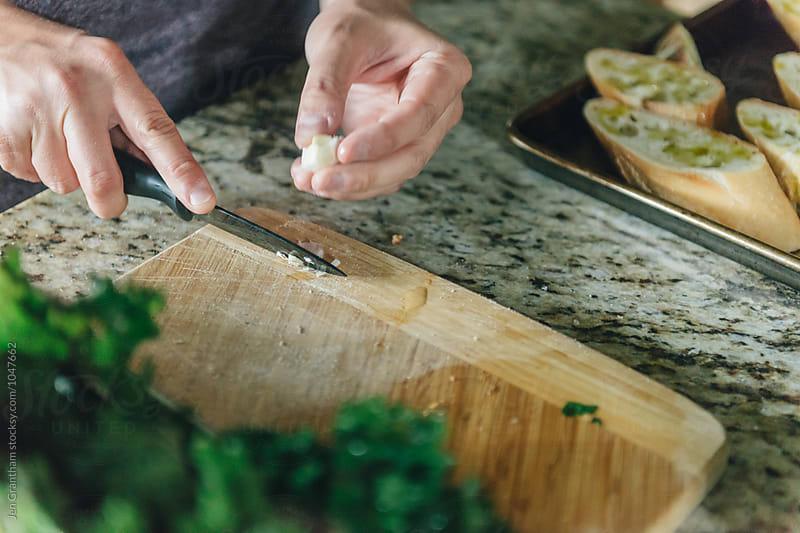 Preparing garlic bread for grill by Jen Grantham for Stocksy United
