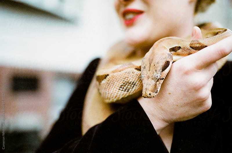 Snake Charmer by Cameron Whitman for Stocksy United