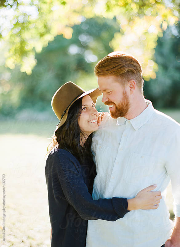 Couple in love smiling at each other by Daniel Kim Photography for Stocksy United