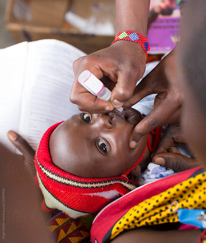 Baby being given polio vaccination. Kenya. Africa. by Hugh Sitton for Stocksy United