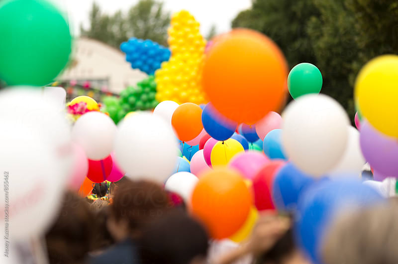 crowd with colorful balloons by Alexey Kuzma for Stocksy United