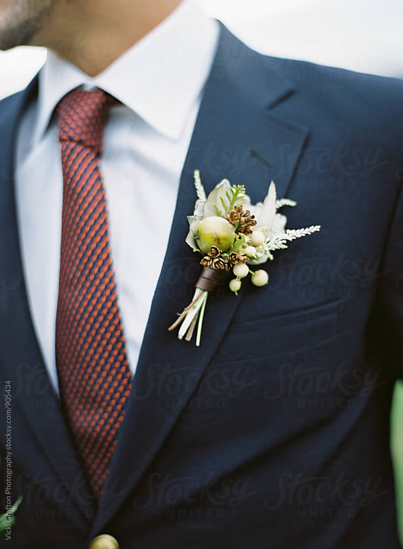 Grooms boutonniere by Vicki Grafton Photography for Stocksy United