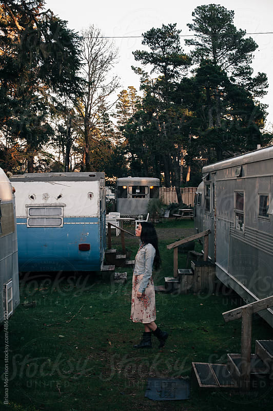 Young Woman Standing in a Retro Trailer Park by Briana Morrison for Stocksy United