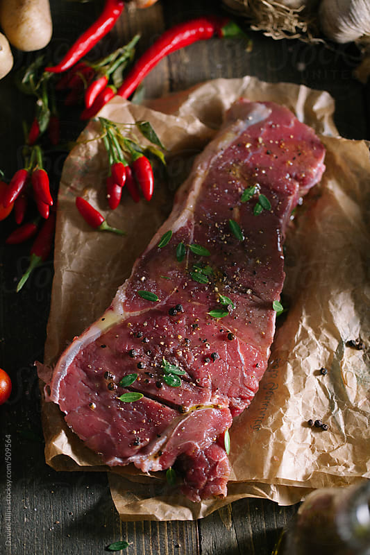Raw beef steak by Davide Illini for Stocksy United