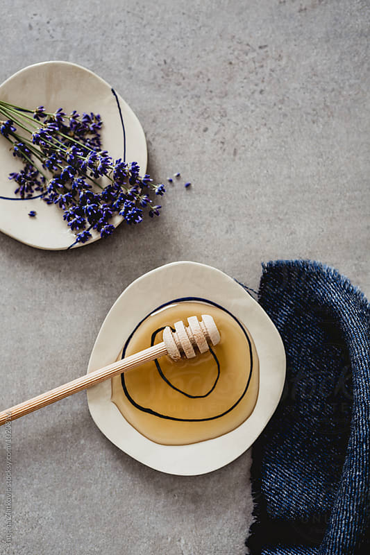 Artistic ceramic plates with honey and lavender by Tatjana Ristanic for Stocksy United