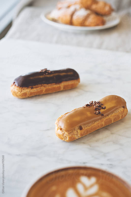 eclairs and coffee by Gillian Vann for Stocksy United