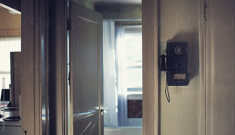 A vintage phone in an old apartment in Portland by Rachel Bellinsky for Stocksy United