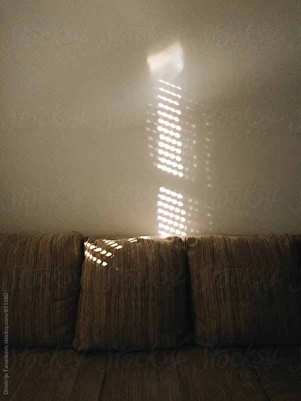 Sun shining through the window in the living room by Dimitrije Tanaskovic for Stocksy United