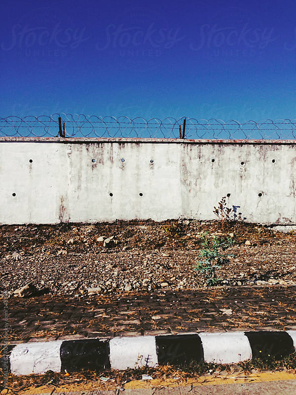 Wall With Barbed Wire by VISUALSPECTRUM for Stocksy United