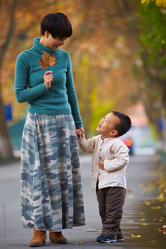 little boy and his mother by Bo Bo for Stocksy United
