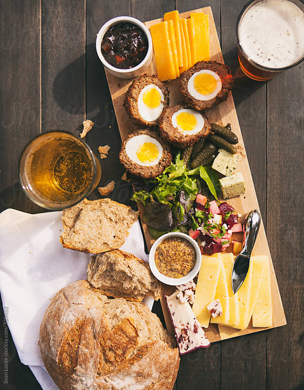 Beer And Hard Cider With British Ploughman's Plate by Sean Locke for Stocksy United