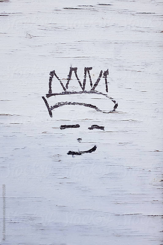 Small illustration on urban wall of person wearing a crown by Paul Edmondson for Stocksy United