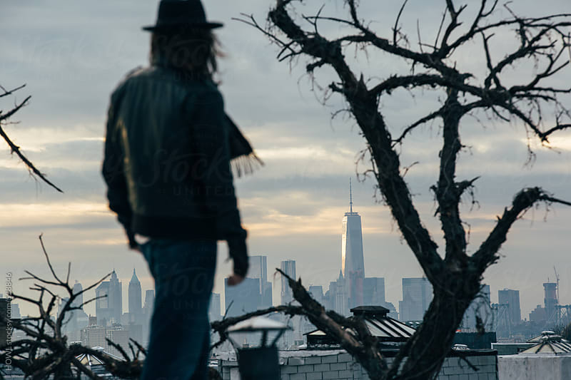 a man overlooks New York City skyline by HOWL for Stocksy United