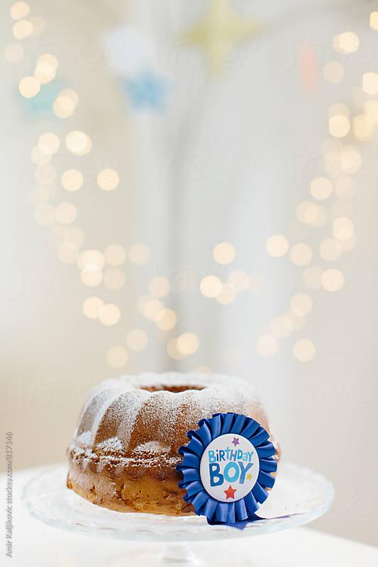 Birthday cake on plate by Amir Kaljikovic for Stocksy United