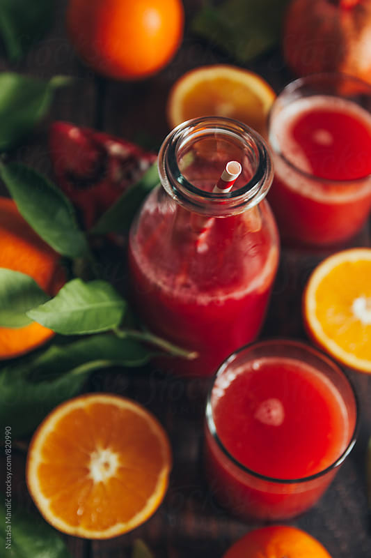 Fresh orange and pomegranate juice by Nataša Mandić for Stocksy United