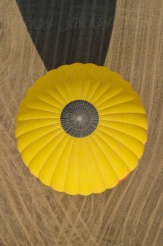 Hot air balloon on a wheat field,Igualada, Spain by Bisual Studio for Stocksy United