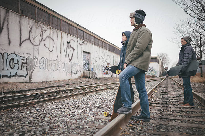 Young Men Friends Hanging Out in Brooklyn Railway by Joselito Briones for Stocksy United