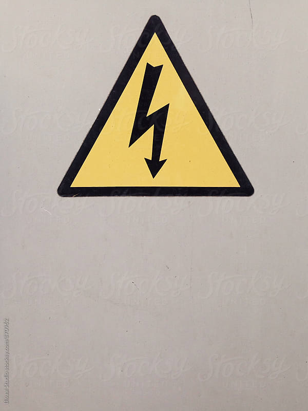High Voltage Sign over a white Background by Bisual Studio for Stocksy United