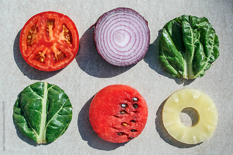 colorful fruits and vegetables in the same shape, circle by Igor Madjinca for Stocksy United
