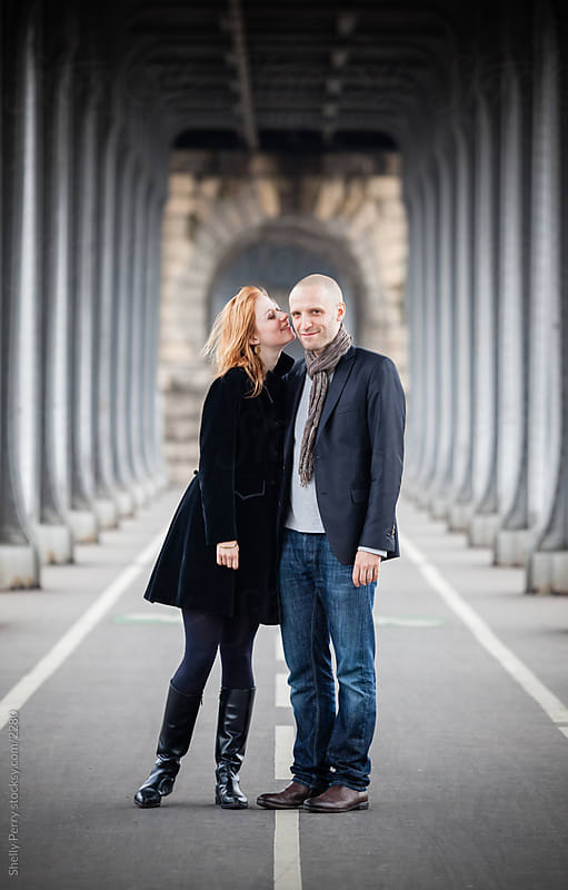 Romantic couple in Paris, woman kissing his cheek by Shelly Perry for Stocksy United