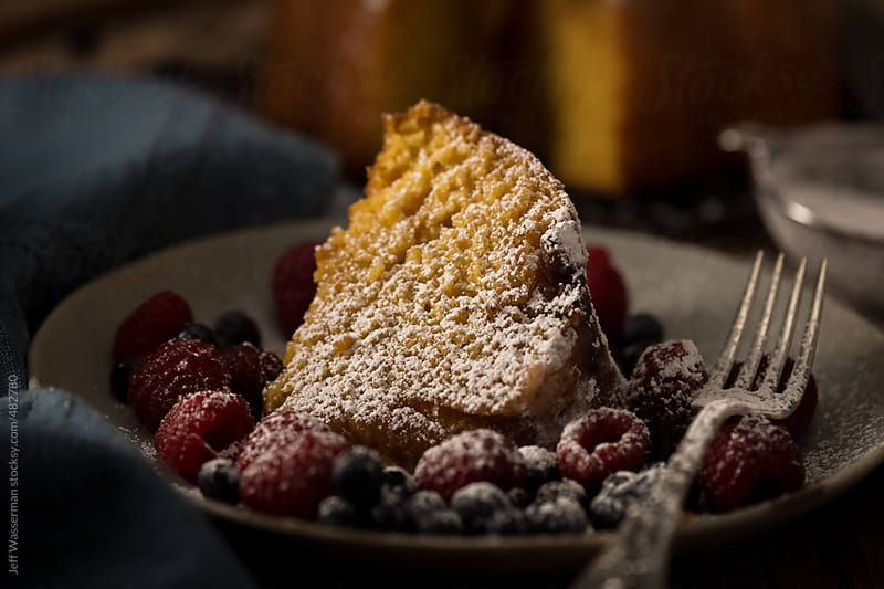 Slice of Rum Cake with Fruit and Icing Sugar by Jeff Wasserman for Stocksy United