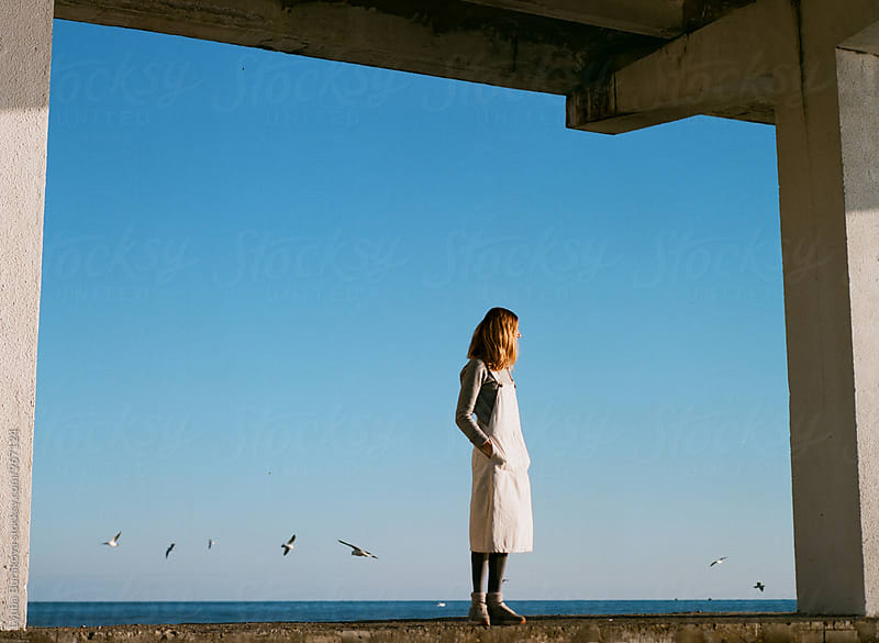 Woman standing at seaside  by Lyuba Burakova for Stocksy United